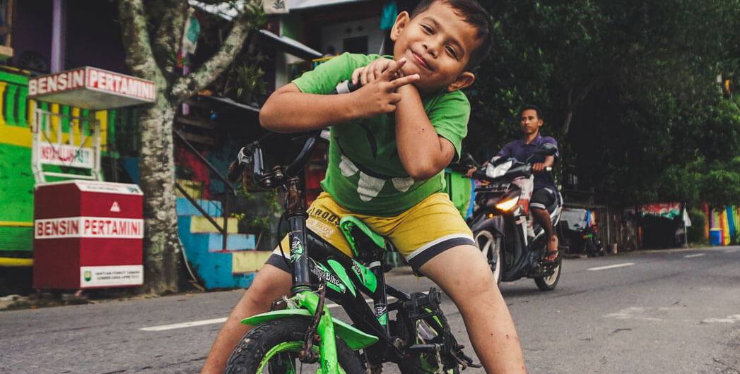 Young Boy riding his bike